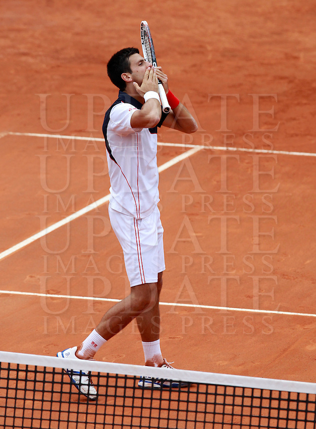 Il serbo Novak Djokovic esulta dopo aver vinto la finale maschile degli Internazionali d'Italia di tennis a Roma, 18 maggio 2014.<br /> Serbia's Novak Djokovic celebrates after winning the men's final match of the Italian open tennis tournament, in Rome, 18 May 2014.<br /> UPDATE IMAGES PRESS/Isabella Bonotto