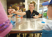 NWA Democrat-Gazette/FLIP PUTTHOFF <br /> STAINED GLASS ARTISTS<br /> Ashlee Bailey with The Scott Family Amazeum helps youngsters make stained glass windows out of candy pieces on Tuesday June 25 2019 at the Boxopolis 2.0 camp. Campers do architecture and design projects at the Amazeum during the camp that runs through June 28. The Amazeum and the Fay Jones School of Architecture and Design at the University of Arkansas teamed up to host the camp.