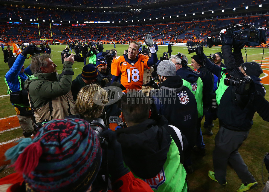 Jan 17, 2016; Denver, CO, USA; Denver Broncos quarterback Peyton Manning (18) is surrounded by photographers and cameramen following the game against the Pittsburgh Steelers during the AFC Divisional round playoff game at Sports Authority Field at Mile High. Mandatory Credit: Mark J. Rebilas-USA TODAY Sports