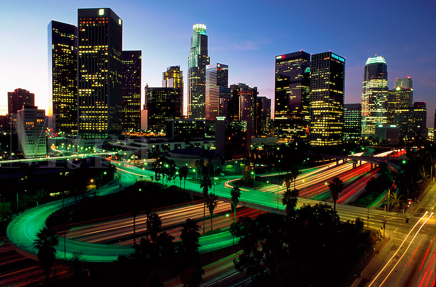 Evening skyline of downtown Los Angeles with freeway in foreground. Los Angeles, California.