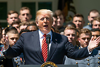 United States President Donald J. Trump makes remarks as he presents the Commander-in-Chief's Trophy to the U.S. Military Academy football team in the Rose Garden of the White House in Washington, DC on Tuesday, May 1, 2018.  The Commander-in-Chief's trophy is presented to the winner of the annual Army-Navy football game which was played at Lincoln Financial Field in Philadelphia, Pennsylvania on December 9, 2017.  The Army Black Knights beat the Navy Midshipmen 14 - 13.<br /> Credit: Ron Sachs / CNP /MediaPunch