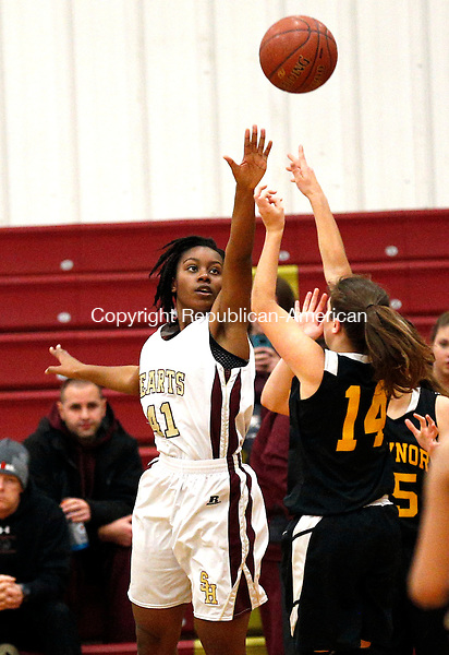 Waterbury, CT- 02 January 2016-010216CM05-  Kaynor Tech's Cassie Couture takes a jump shot against Sacred Heart's Mahnue Sahn defends during the Sacred Heart Holiday Tournament in Waterbury on Saturday.      Christopher Massa Republican-American