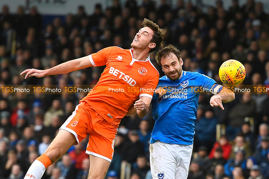 Ben Heneghan of Blackpool and Brett Pitman of Portsmouth challenge for a header during Portsmouth vs Blackpool, Sky Bet EFL League 1 Football at Fratton Park on 12th January 2019