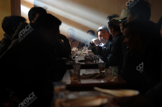 Men and women chatted over breakfasts of noodles and tea at a traditional tea house in central Lhasa, Tibet. November 14, 2006