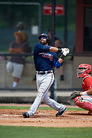 Atlanta Braves third baseman Jose Bautista (1) hits a long fly ball, that left fielder Adron Chambers (not shown) made a leaping catch at the wall for the out, in the top of the third inning during a Minor League Extended Spring Training game against the Philadelphia Phillies on April 20, 2018 at Carpenter Complex in Clearwater, Florida.  Catching for the Phillies is Rafael Marchan.  (Mike Janes/Four Seam Images)