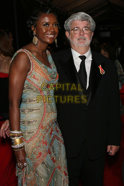 MELLODY HOBSON & GEORGE LUCAS.The 2010 NBC, Universal Pictures & Focus Features' Annual Golden Globes After-Party at the Beverly Hilton, Beverly Hills, CA, USA.                                                                         January 17th, 2010.globes half 3/4 length black suit blue pink red gold silver pattern glasses beard facial hair married husband wife bracelets .CAP/LNC/AM.©Alba Montes/LNC/Capital Pictures