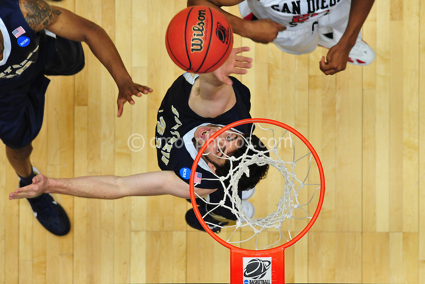 Mar 17, 2011; Tucson, AZ, USA; Northern Colorado Bears forward/center Mike Proctor (41) tries to block a shot during a game against the San Diego State Aztecs in the second round of the 2011 NCAA men's basketball tournament at the McKale Center. The Aztecs won 68-50.