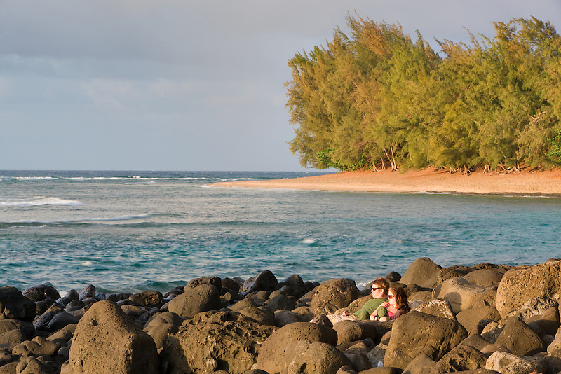 Couple viewing sunst at Kee beach. Kauai, Hawaii
