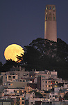 August full moon rising over San Francisco's Coit Tower.