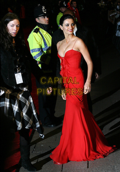 PENELOPE CRUZ  .The Last Samurai premiere, Odeon Leicester Square.6 January 2004.long red dress, cleavage, full length, full-length, policeman.www.capitalpictures.com.sales@capitalpictures.com.©Capital Pictures