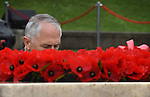 AUSTRALIA, Canberra : Australian Prime Minister Malcolm Turnbull lays a wreath during the remembrance service at the Australian War Memorial, Wednesday, November 11, 2015. AFP PHOTO / MARK GRAHAM