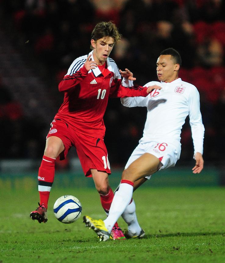 England's Jacob Murphy vies for possession with Denmark's Danny Amankwaa ..Football - U19 International Friendly - England v Denmark - Tuesday 5th February 2013 - Keepmoat Stadium - Doncaster..