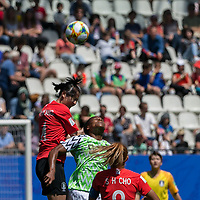 GRENOBLE, FRANCE - JUNE 12: Boram Hwang #4 of the Korean National Team, Desire Oparanozie #9 of the Nigerian National Teambattle for the ball. during a game between Korea Republic and Nigeria at Stade des Alpes on June 12, 2019 in Grenoble, France.