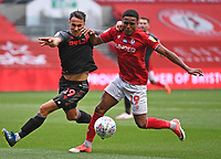 15th July 2020; Ashton Gate Stadium, Bristol, England; English Football League Championship Football, Bristol City versus Stoke City; Lee Gregory of Stoke City competes for the ball with Niclas Eliasson of Bristol City