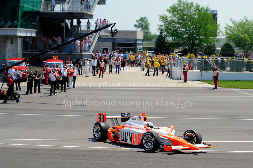 Bryan Herta pulls onto the track to do a lap of honoring the late Dan Wheldon's 2011 Indy 500 winning car.