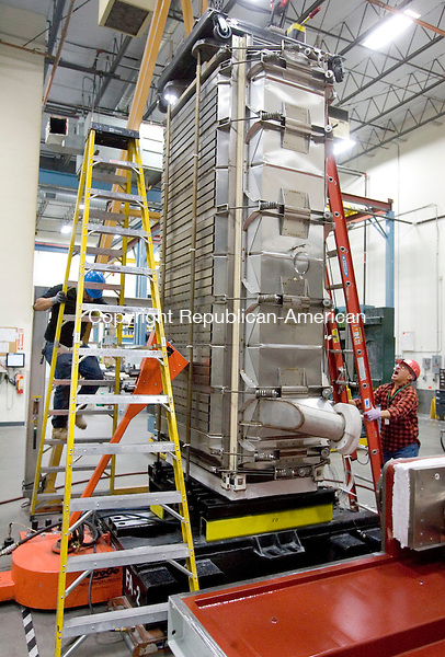 TORRINGTON CT. 15 September 2014-091514SV09-From left, Eric Hughes of Waterbury and Galo Perez of Torrington assemble a fuel cell at FuelCell Energy in Torrington Monday. <br /> Steven Valenti Republican-American