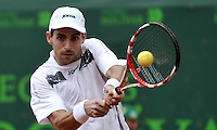 BOGOTA - COLOMBIA -07 -11-2013: Santiago Giraldo, tenista colombiano devuelve la bola a Ariel Behar, tenista de Argentina, durante partido de la segunda ronda del Seguros Bolivar Open en el Club Campestre el Rancho de la ciudad de Bogota. / Santiago Giraldo Colombian tennis player returns the ball to Ariel Behar, Argentina tennis player during a match for the second round of the Seguros Bolivar Open in the Club Campestre El Rancho in Bogota city.Photo: VizzorImage  / Luis Ramirez / Staff.