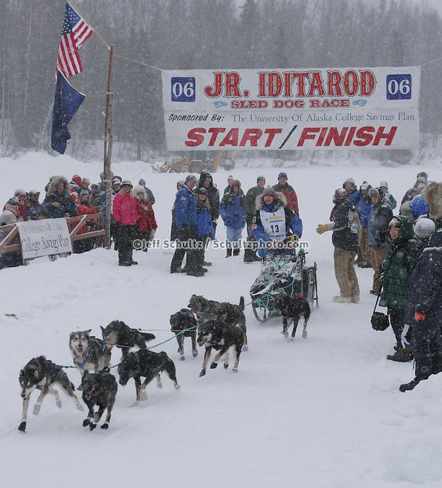 Saturday February 25, 2006 Willow, Alaska. Nikolai Buser leaves the start lineduringt the start day of the Junior Iditarod sled dog race.  Willow Lake.