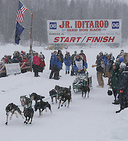 Saturday February 25, 2006 Willow, Alaska. Nikolai Buser leaves the start lineduringt the start day of the Junior Iditarod sled dog race.  Willow Lake.