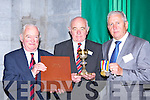 Michael Leane  holding the book of remembrance, Noel Grimes holding the chalice of Fr Donal O'Sullivan Killarney who was killed on 5th July 1915 on the Somne, and Donal Whitty O'Sullivan with his father Daniel medals at the Killarney WW1 remembrance ceremony in St Mary's cathedral on Sunday