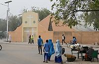 NIGER, Maradi, catholic church, cathedral, walking muslim women / Katholische Kirche, Kathedrale, muslimische Mädchen