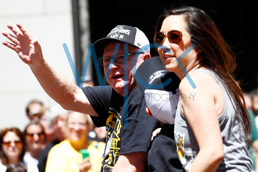 Pittsburgh Penguins general manager Jim Rutherford waves to the fans during the Stanley Cup victory parade in downtown Pittsburgh, Pennsylvania on June 15, 2016. (Photo by Jared Wickerham / DKPS)