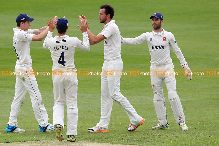 Tom Moore (2nd R) of Essex celebrates the wicket of Jason Roy - Essex CCC vs Surrey CCC - LV County Championship Division Two Cricket at the Essex County Ground, Chelmsford, Essex - 26/05/14 - MANDATORY CREDIT: Gavin Ellis/TGSPHOTO - Self billing applies where appropriate - 0845 094 6026 - contact@tgsphoto.co.uk - NO UNPAID USE