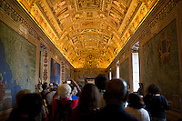 Tourists make their way through the Gallery of Maps during a tour of the Vatican Museums on Thursday, Sept. 24, 2015. (Photo by James Brosher)