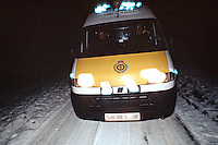 Ambulance attending an emergency in poor weather conditions. This image may only be used to portray the subject in a positive manner..©shoutpictures.com..john@shoutpictures.com