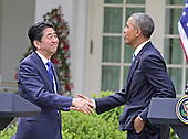 United States President Barack Obama, right, and Prime Minister Shinzo Abe of Japan, left, shake hands after conducting a joint press conference in the Rose Garden of the White House in Washington, D.C. on Tuesday, April 28, 2015.<br /> Credit: Ron Sachs / CNP