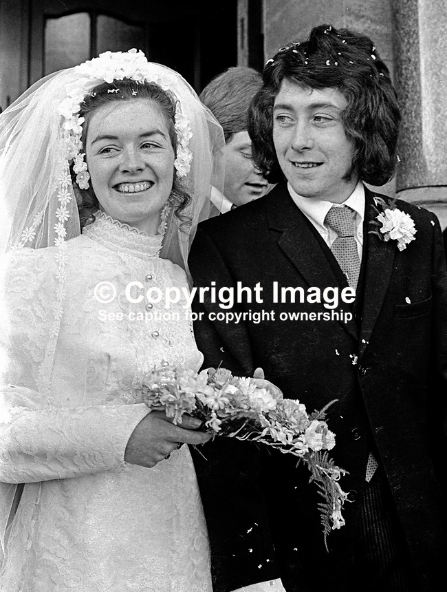 Internees James Bowers with his bride, Mary Curry, after their wedding in Holy Cross Roman Catholic Church, Ardoyne, Belfast, N Ireland, UK, 12th February 1972, 197202120067..Copyright Image from Victor Patterson, 54 Dorchester Park, Belfast, UK, BT9 6RJ..Tel: +44 28 9066 1296.Mob: +44 7802 353836.Voicemail +44 20 8816 7153.Skype: victorpattersonbelfast.Email: victorpatterson@me.com.Email: victorpatterson@ireland.com (back-up)..IMPORTANT: If you wish to use this image or any other of my images please go to www.victorpatterson.com and click on the Terms & Conditions. Then contact me by email or phone with the reference number(s) of the image(s) concerned.