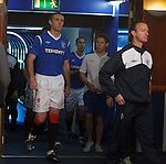 Players get changed for training after the team photo at Ibrox