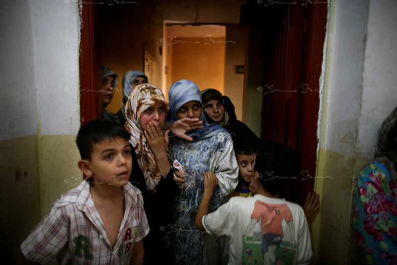 Beirut, Lebanon, Aug 13 2006.Mrejéh, 14:45, panic stricken civilians in their building staircase as 20 heavy explosions from an intense Israeli Air Force bombing less than a kilometer away..