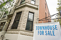 Sign for townhouse for sale in Harlem in New York on Sunday, August 31, 2014. (© Richard B. Levine)