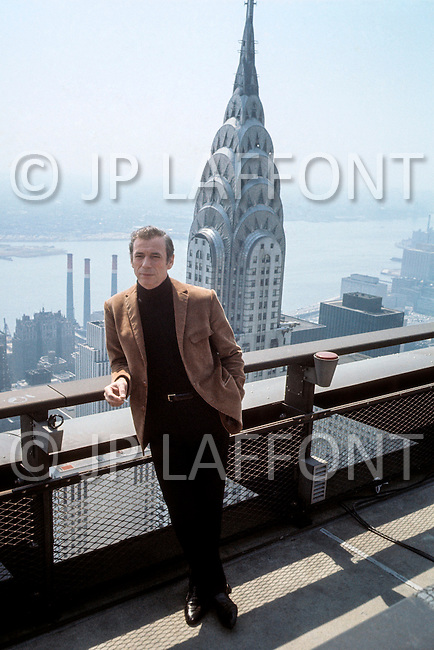 "Manhattan, New York City. May 1969. Picture of Yves Montand taken on top of the Pan Am building. Yves Montand is playing a role on top of the building for the film ""On a Clear Day You Can See Forever"" directed by Vincent Minnelli and co-starring Barbara Streisand. Yves Montand (October 13, 1921 - November 9, 1991) was an Italian-born French actor and singer, who was discovered by renown singer ´Edith Piaf, and is most known for his performance in the movie Jean de Florette."