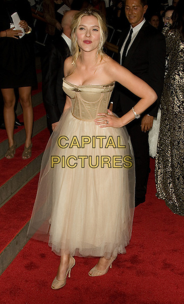 "SCARLETT JOHANSSON.Costume Institute Gala - ""Superheroes: Fashion and Fantasy"" at The Metropolitan Museum of Art, New York, NY, USA..May 5th, 2008 .full length white gold cream beige sheer chiffon strapless dress hand on hip.CAP/LNC/TOM.©TOM/LNC/Capital Pictures."