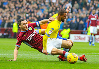Leeds United's Kemar Roofe is tackled by Aston Villa's James Chester<br /> <br /> Photographer Alex Dodd/CameraSport<br /> <br /> The EFL Sky Bet Championship - Aston Villa v Leeds United - Sunday 23rd December 2018 - Villa Park - Birmingham<br /> <br /> World Copyright &copy; 2018 CameraSport. All rights reserved. 43 Linden Ave. Countesthorpe. Leicester. England. LE8 5PG - Tel: +44 (0) 116 277 4147 - admin@camerasport.com - www.camerasport.com