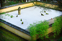 """The sand and stone garden (Karesansui) surrounded by wall capped with Gifu tile in the Portland Japanese Garden.   The sand and seven carefully placed rocks reflects Japanese aesthetic principle of """"the beauty of blank space""""."""