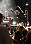 Train front man Pat Monahan takes selfies with phones from the audience during a concert at Harveys Lake Tahoe Outdoor Arena at Stateline, Nev., on Friday, July 25, 2014. <br /> Photo by Cathleen Allison
