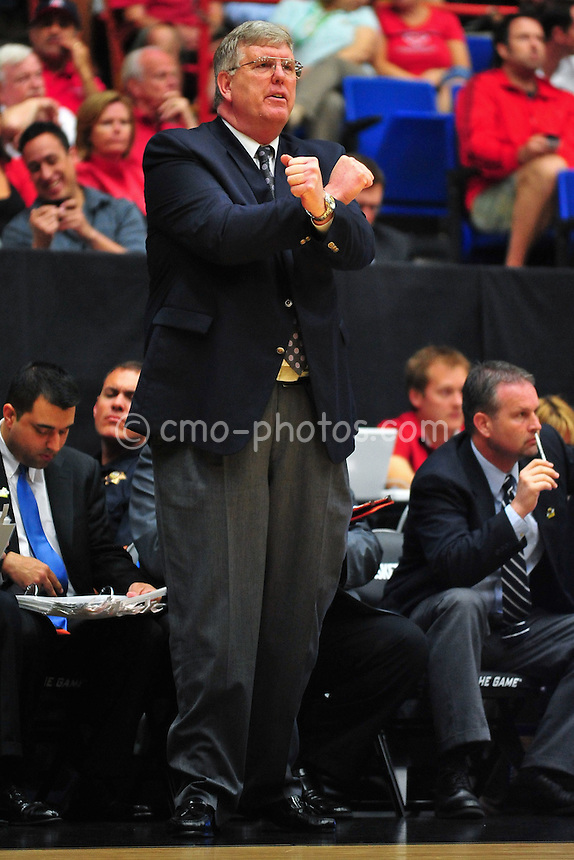Mar 17, 2011; Tucson, AZ, USA; Utah State Aggies head coach Stew Morrill gestures to his team in the first half of a game against the Kansas State Wildcats in the second round of the 2011 NCAA men's basketball tournament at the McKale Center.
