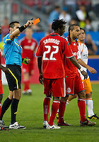 01 July 2010:  Toronto FC midfielder Amadou Sanyang #22 receives a second yellow card from referee Jair Marrufo resulting in a red card during a game between the Houston Dynamo and the Toronto FC at BMO Field in Toronto..Final score was 1-1....