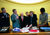 During his morning briefing, President George W. Bush reviews the progress of the war with members of the War Council Wednesday, April 2, 2003. Pictured with the President are, from left, Chairman of the Joint Chiefs of Staff Richard B. Myers, US Vice President Dick Cheney, Chief of Staff Andy Card, US Secretary of Defense Donald Rumsfeld and National Security Advisor Condoleezza Rice. <br /> Mandatory Credit: Eric Draper / White House via CNP