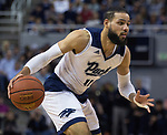 Nevada forward Cody Martin (11) drives against Utah State in the first half of an NCAA college basketball game in Reno, Nev., Wednesday, Jan. 2, 2019. (AP Photo/Tom R. Smedes)