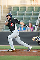 Jose Cardona (8) of the Hickory Crawdads follows through on his swing against the Kannapolis Intimidators at CMC-Northeast Stadium on May 21, 2015 in Kannapolis, North Carolina.  The Intimidators defeated the Crawdads 2-0 in game two of a double-header.  (Brian Westerholt/Four Seam Images)