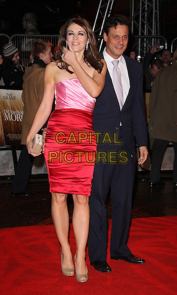 ELIZABETH HURLEY & ARUN NAYER.UK Premiere of  'Did You Hear About The Morgans?' at the Odeon, Leicester Square, London, UK..December 8th, 2009.full length pink red silk satin ruched dress peep toe shoes patent beige Liz gold clutch bag black suit married strapless husband wife hand.CAP/ROS.©Steve Ross/Capital Pictures.