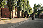 Red barracks and Guard Tower Appellplatz in Auschwitz camp Poland, holocaust museum of World War 2