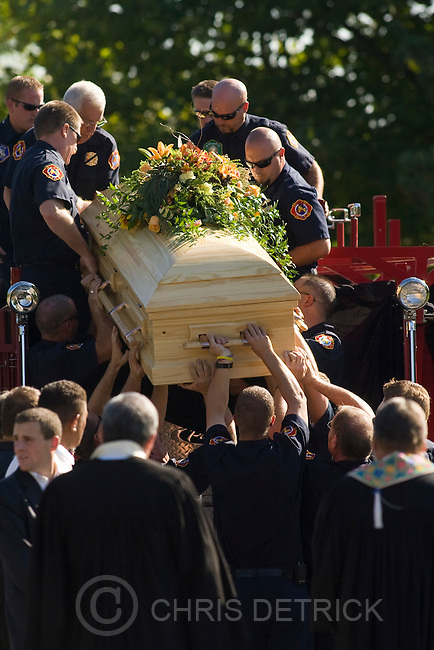 Members of the Farmington Fire Department lift the casket off of a fire truck during the funeral service at the Farmington City Cemetary for Brian P. Wood Friday, September 26, 2008.  Wood was shot and killed by a Davis County Sheriff's Office deputy on September 22 after a 12-hour standoff. Wood was a part-time firefighter for Farmington's fire department...Chris Detrick/The Salt Lake Tribune.
