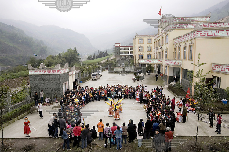 Han Chinese women dance while dressed in traditional Tibetan dress to symbolise the unity of the country.  This is a rehearsal of a display under the slogan: 'The same line as the Party, the same direction towards Socialism'. Organised by the XuanKou Village. The display called for Chinese unity in the face of so-called 'Tibetan Separatists'.