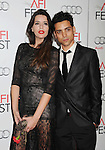 HOLLYWOOD, CA - NOVEMBER 03: Anabela Moreira and Rafael Morais arrive at the 2012 AFI FEST - 'Holy Motors' Gala Screening at Grauman's Chinese Theatre on November 3, 2012 in Hollywood,