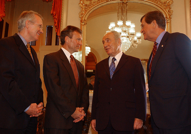 2Peres102201 -- From left, Sens. Harry Reid, D-N.M., Tom Daschle, D-S.D., Shimon Peres, Foreign Minister to Israel, and Sen. Trent Lott, R-Miss., meet to discuss the situation in the Middle East.